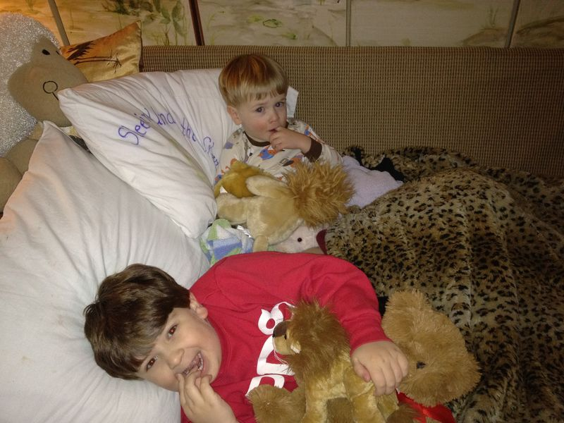 Boys snuggle on couch