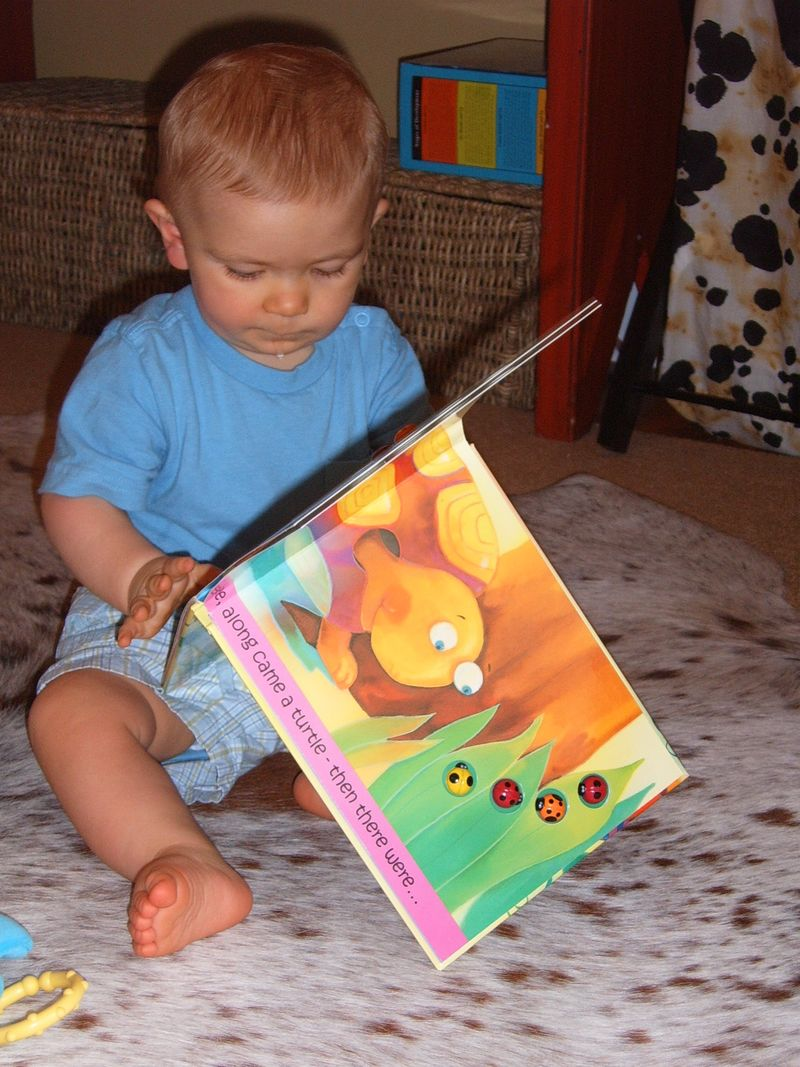 Toddler B with book 1